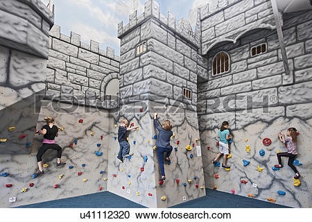 Stock Photography of Group of children playing and climbing at.