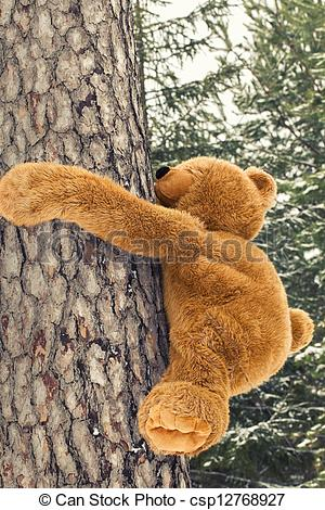 Clip Art of Toy bear climbing on a tree in forest csp12768927.