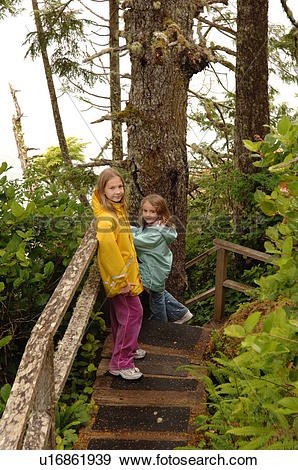 Stock Photograph of Two girls climbing stairs in forest u16861939.