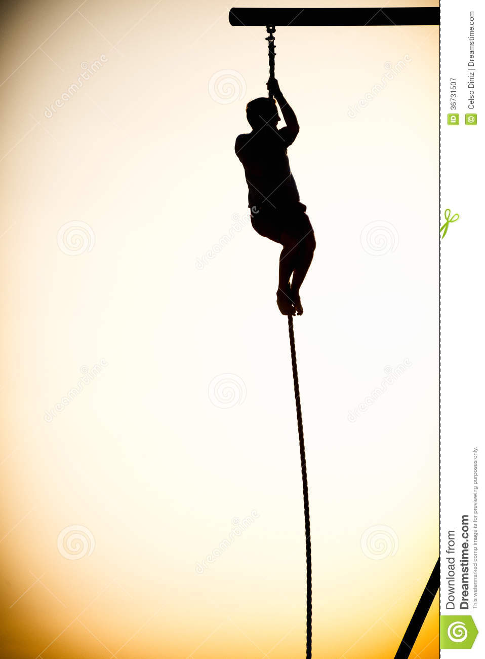 Silhouette Of A Person Climbing A Rope Royalty Free Stock.