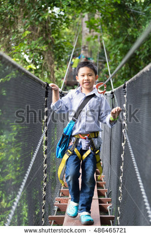 Young Child Climbing Rope Tower Stock Photo 13978567.