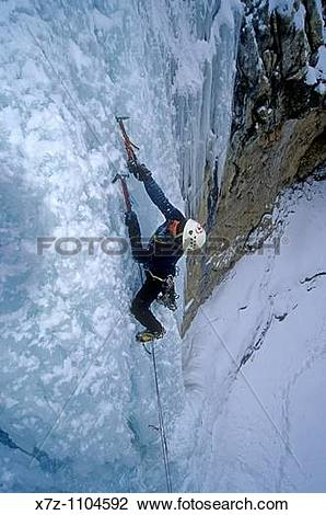 Stock Photo of Man, ice climbing The Boy Scout ice route in.