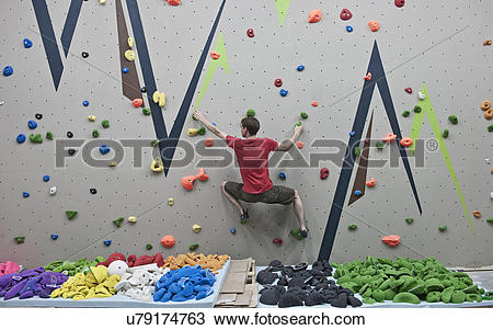 Stock Photo of Route setter trying bouldering problem at indoor.