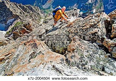 Stock Photo of free solo rock climbing The Direct South Ridge.