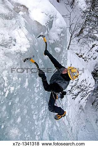 Pictures of Man ice climbing a route called Genesis which is rated.