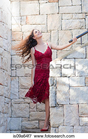 Picture of Woman climbing stone steps outdoors is09a64f7.