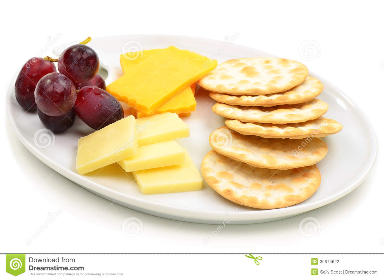 Cheese and crackers stock photo. Image of white, plate.