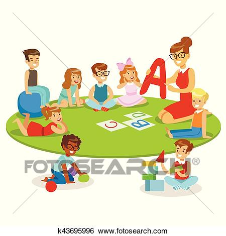 Young Children Learning Alphabet And Playing In Nursery School With Teacher  Sitting And Laying On The Floor Clip Art.