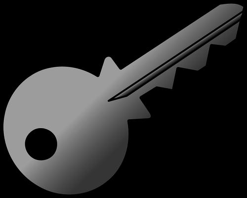 Vector clip art of grey shaded metal door key.