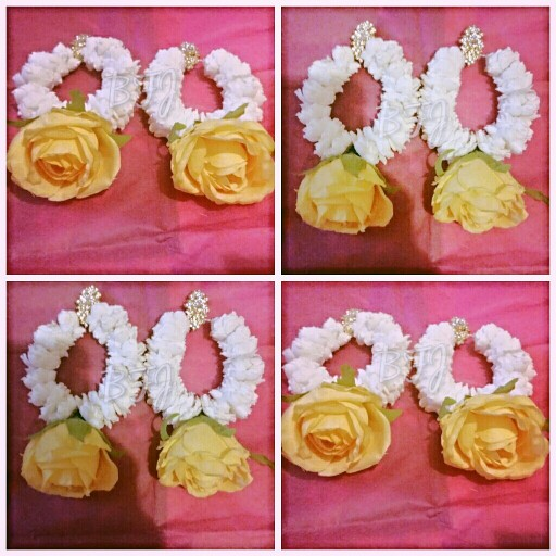 Clip on flower hoops made from artificial flowers by bridal flower.