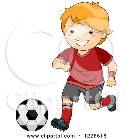 Clipart of a Happy Red Haired Caucasian Boy Playing Soccer.