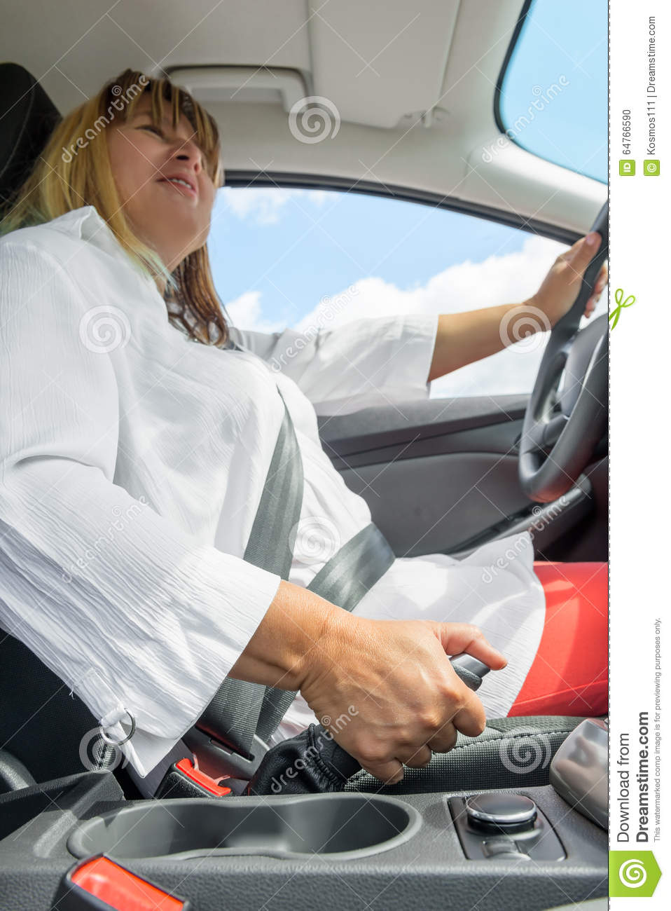 Woman In A Car Holding The Handbrake Stock Photo.