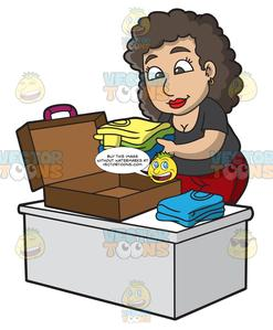 A Woman Packing Her Suitcase For A Vacation.