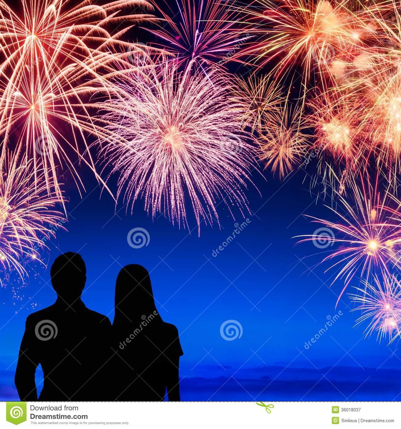 Couple Enjoying A Fireworks Display Royalty Free Stock Photography.