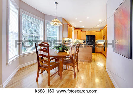Stock Photography of Dining area dn kitchen with maple oak wood.