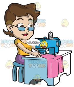 A Fashion Designer Sewing Her New Clothes.