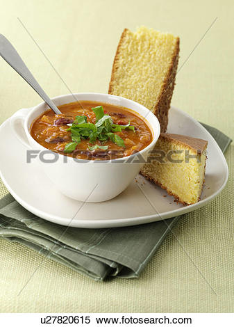Stock Image of Chilli bean soup and cornbread editorial food.