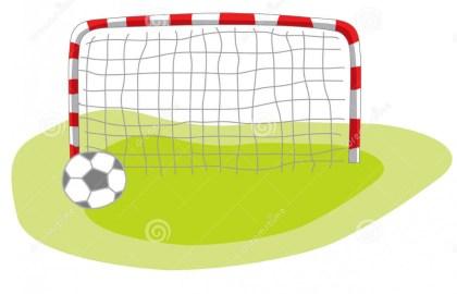 Soccer Football in Goal Net.