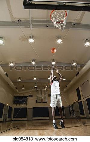 Pictures of Black man shooting basketball on basketball court.