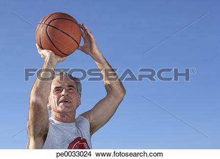 Stock Photo of man shooting a basketball pe0033024.