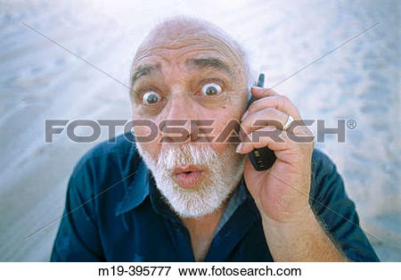 Picture of man with funny face/big eyes on cell phone m19.