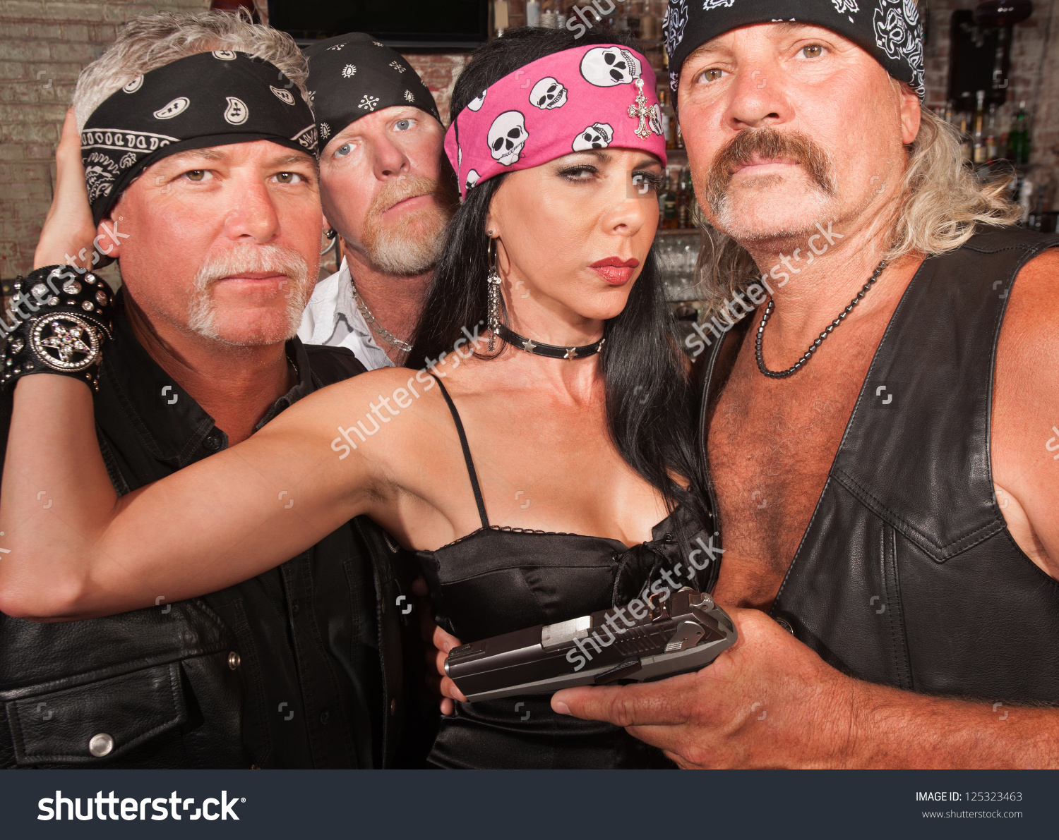 Three Motorcycle Gang Members Beautiful Woman Stock Photo.
