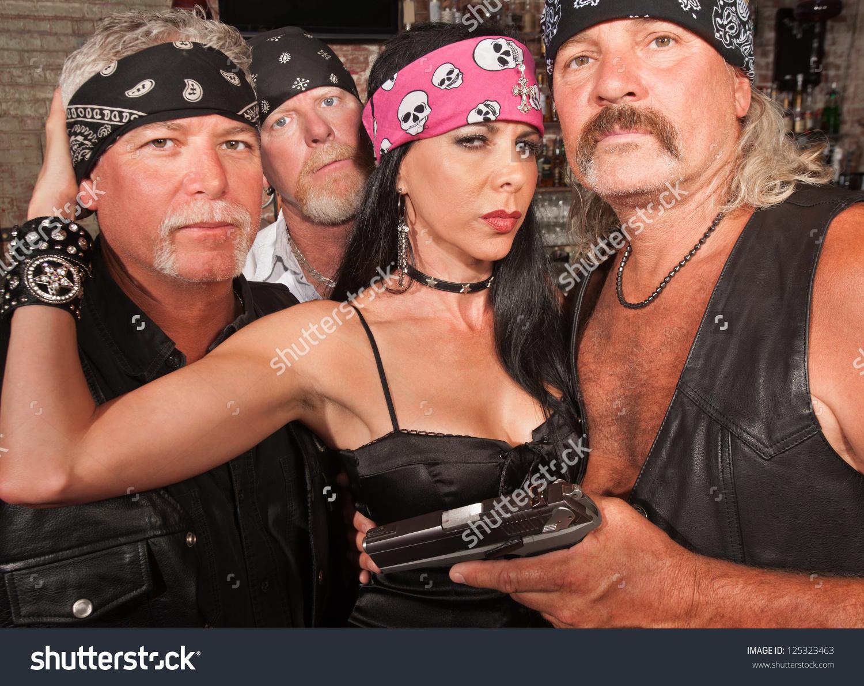 Three Motorcycle Gang Members Beautiful Woman Stock Photo.