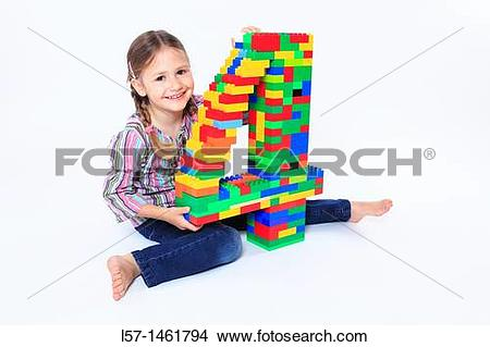 Stock Photo of Little girl playing with Lego, Switzerland l57.