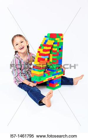 Stock Image of Little girl playing with Lego, Switzerland l57.