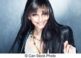 Pictures of smiling long black hair girl with blue eyes.