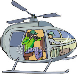 Cameraman Taking Video From Inside a Helicopter.