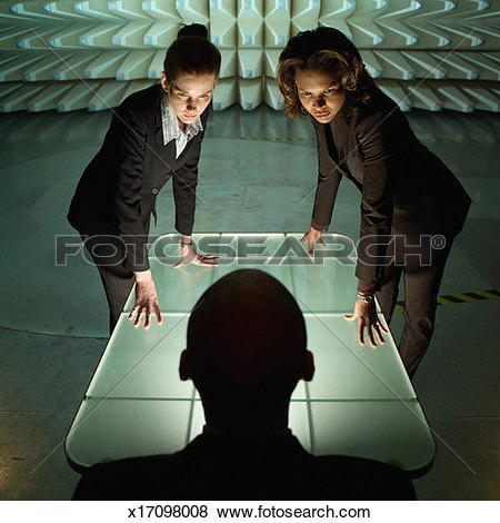 Pictures of Two women leaning on table looking down at man sitting.