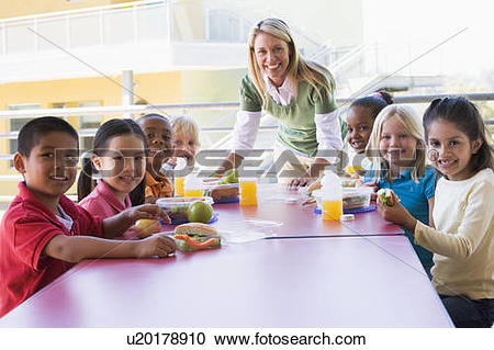 Stock Photography of Teacher leaning on table outdoors while.