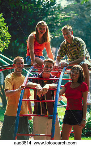 Stock Photo of Outdoor portrait of five teenagers, three boys and.