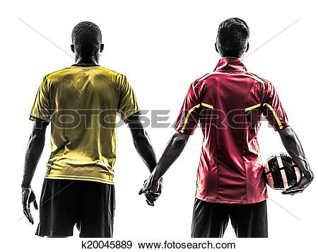 Stock Photograph of two men soccer player standing holding hands.