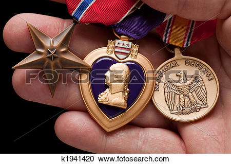 Stock Photography of Man Holding Purple Heart, Bronze and National.