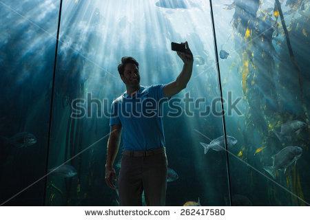 Clipart man lookin at fishtank.