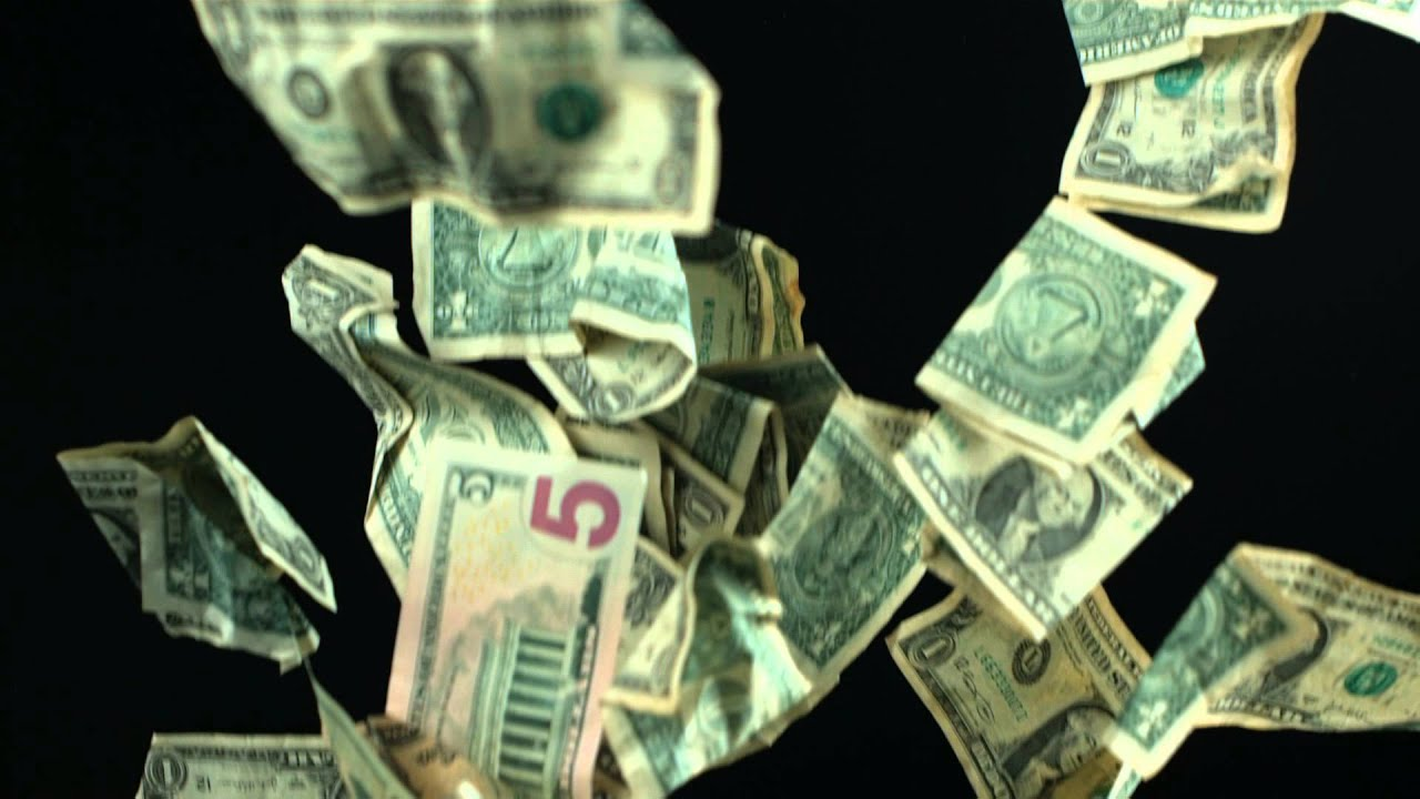 Slow Motion Falling Money HD US Dollars Fall from the Sky with Video Shot  in High Definition Format.