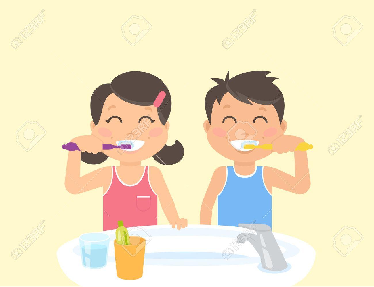 Happy kids brushing teeth standing in the bathroom near sink.