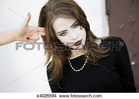 Stock Photo of Girl Pointing Imaginary Gun At Her Head k4026594.