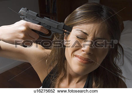 Stock Photo of Scared woman with gun to her head u16275652.