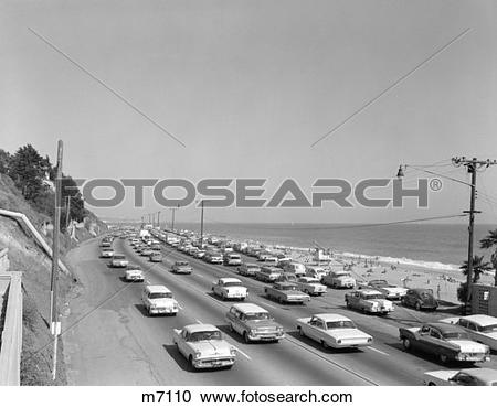 Stock Photography of 1950S 1960S Highway Traffic Cars Along Malibu.