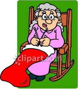 Older Woman Knitting A Christmas Stocking.