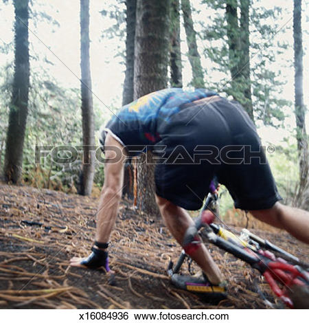 Stock Images of Man Falling Off His Mountain Bike x16084936.