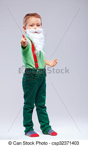 Stock Photography of funny kid santa claus with thumb up finger.