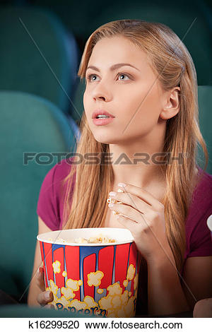 Stock Photography of Excited young women at the cinema. Portrait.