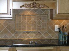 Silver & Gold Granite countertops with black cabinets. Travertine.