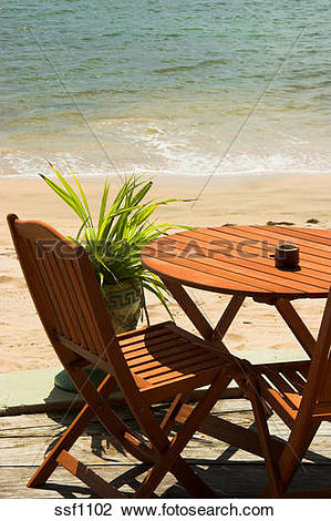 Stock Photo of Patio Table and Chairs just off the beach.