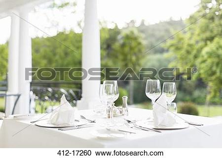 Stock Photography of Place settings on patio table 412.