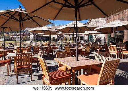 Stock Image of Outdoor patio dining at a mountain resort lodge.